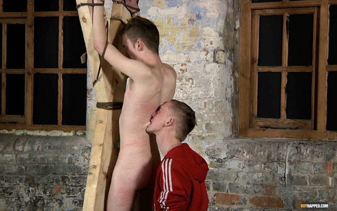 Tied to Cross and Flogged