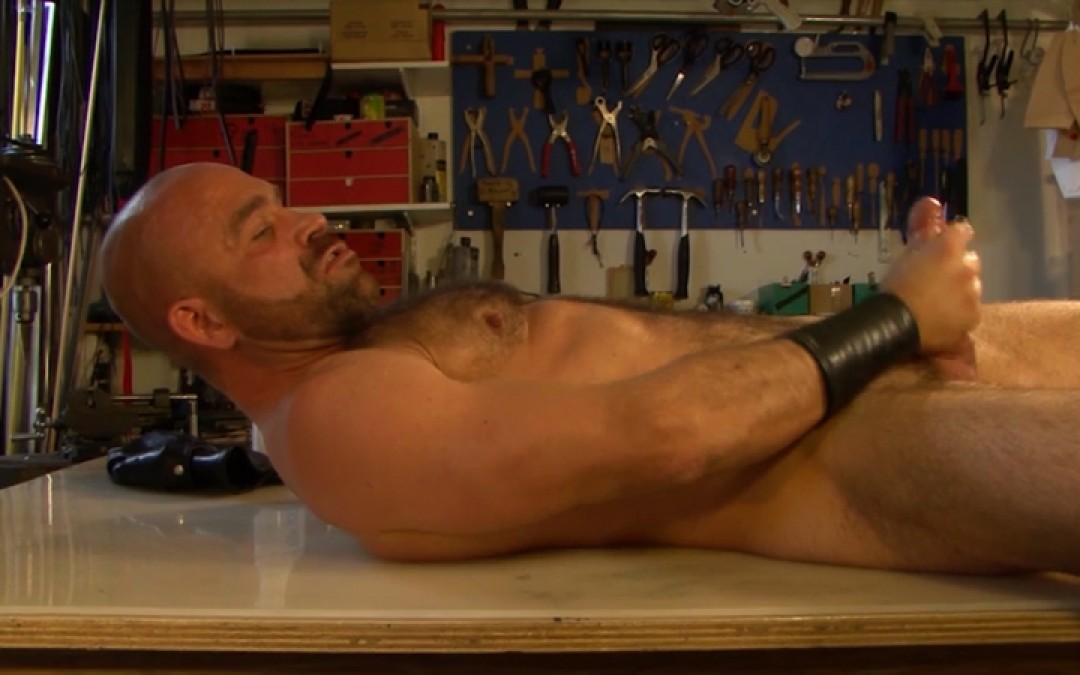 Manly dude stroking in the garage