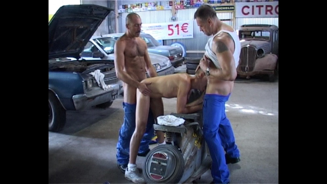 Twink fucked by two garage owners