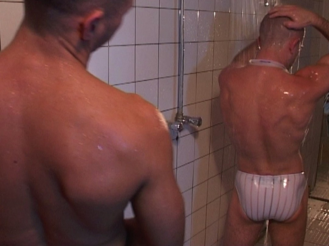 Two swimmers fuck in the shower