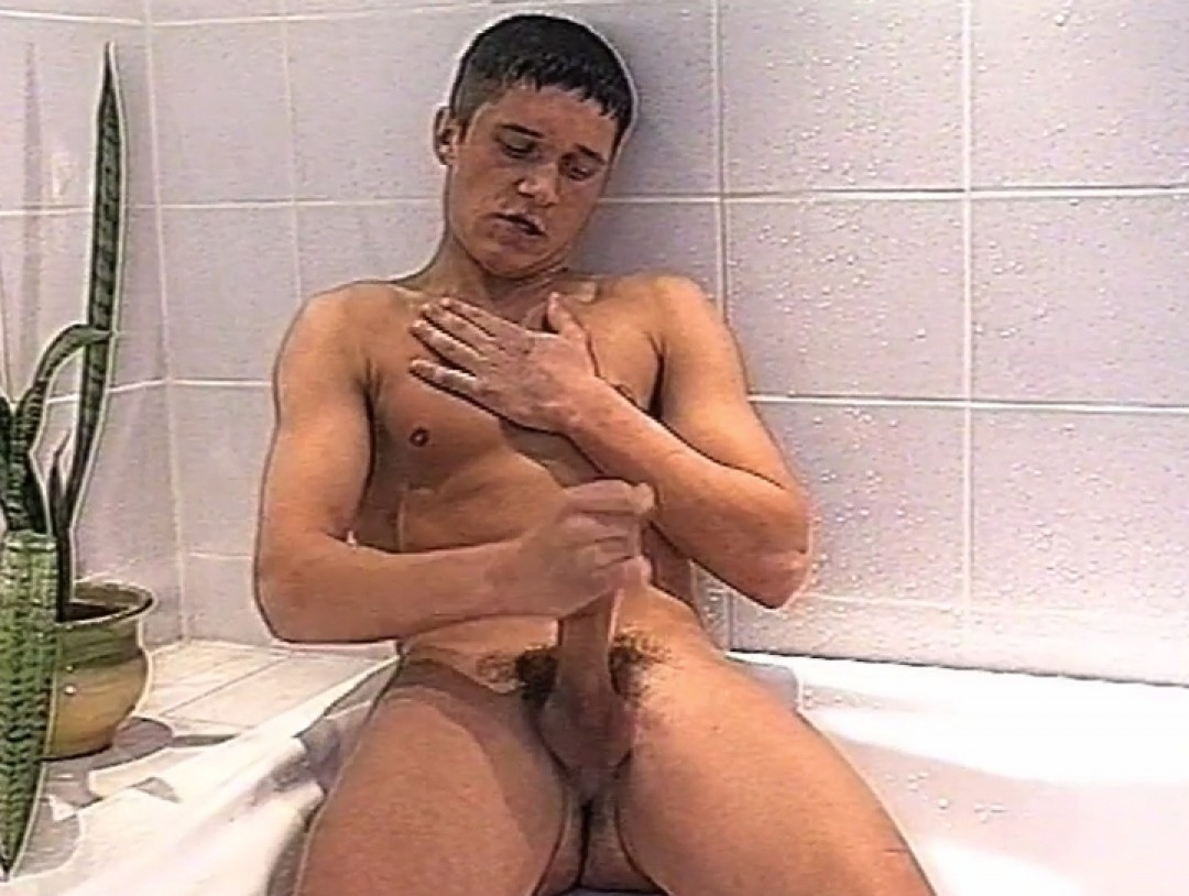 Young swimmer plays in the shower