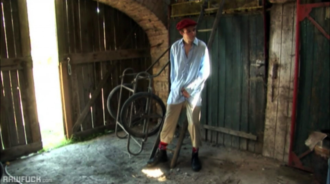 Stroking gay cock in the barn