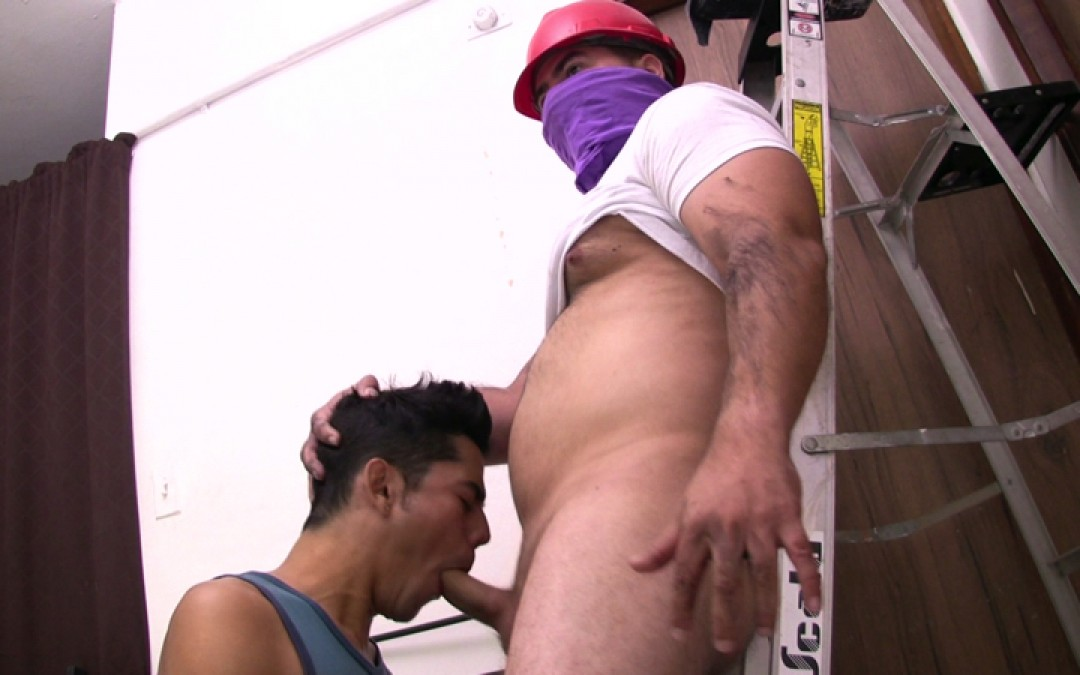 Young man servicing his boss on construction site