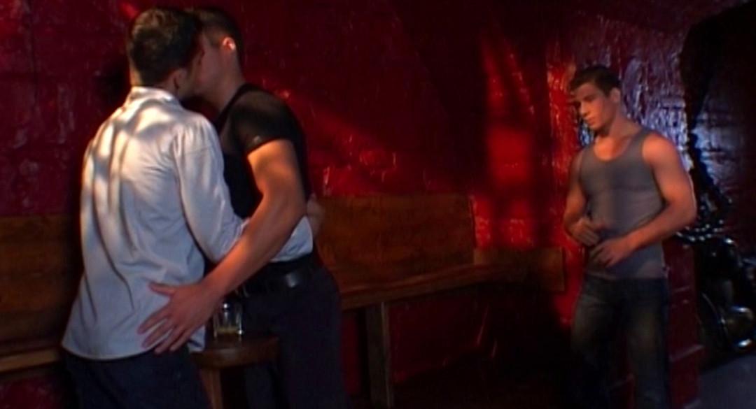 Gay Threesome between studs at the cruising bar