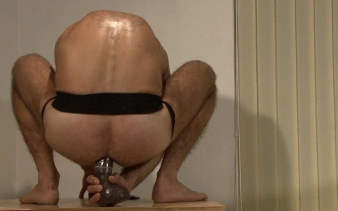 Bad boy putting a big dildo in his ass
